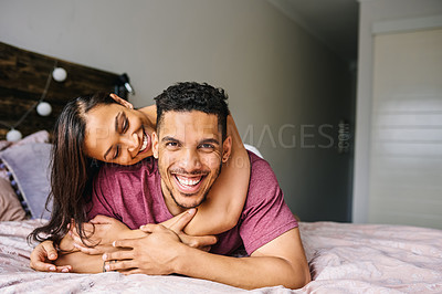 Buy stock photo Portrait of a happy young couple having fun in the bedroom at home