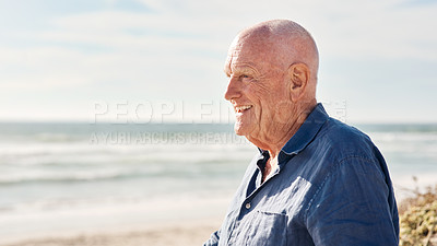 Buy stock photo Shot of a senior man spending a day at the beach