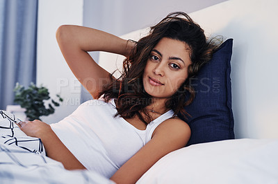 Buy stock photo Cropped portrait of an attractive young woman waking up in her bed after sleeping in at home