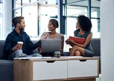 Buy stock photo Shot of a group of young businesspeople planning and discussing ideas together in their office lounge area at work