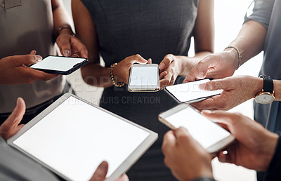 Buy stock photo Cropped shot of an unrecognizable group of businesspeople using their digital devices in synchronicity