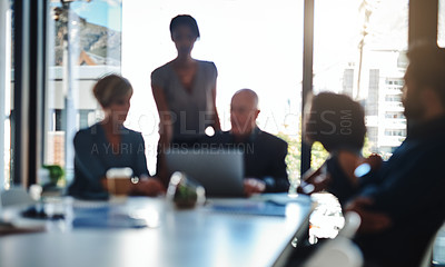 Buy stock photo Defocused shot of a group of businesspeople having a meeting together at wok