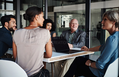 Buy stock photo Shot of a group of businesspeople having a boardroom meeting at work