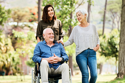Buy stock photo Cropped shot of a young woman spending the day outdoors with her elderly parents