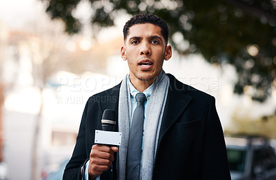 Buy stock photo Portrait of a handsome young news reporter covering a story outdoors in the city