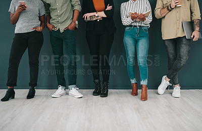 Buy stock photo Shot of a group of young businesspeople waiting in line for an interview