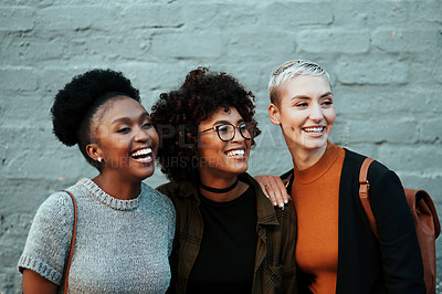 Buy stock photo Shot of a group of attractive young creative businesswomen posing and relaxing together outside in the city