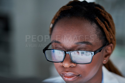 Buy stock photo Closeup shot of an attractive young female scientist using a computer while working in a laboratory