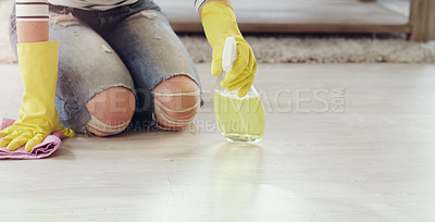 Buy stock photo Cropped shot of a young woman cleaning her floors at home