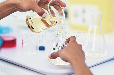 Buy stock photo Closeup of an unrecognizable female scientist mixing chemicals together inside of a laboratory