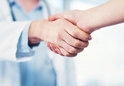 Buy stock photo Closeup of an unrecognizable doctor shaking hands with a patient inside of a hospital during the day