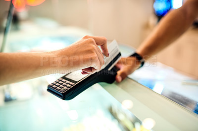 Buy stock photo Shot of a woman paying at the checkout of an ice cream parlour with a credit card