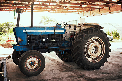 Buy stock photo Still life shot of a tractor parked at a farm