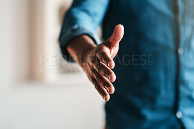 Buy stock photo Cropped shot of an unrecognizable businessman standing alone in his home office and extending his hand for a handshake