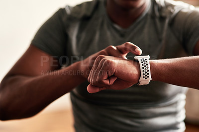 Buy stock photo Cropped shot of an unrecognizable man checking his wristwatch