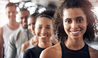 Buy stock photo Shot of a group of young people standing together in a line at the gym