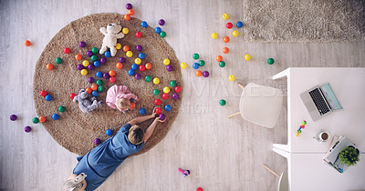 Buy stock photo High angle shot of a mother playing with her baby daughter at home