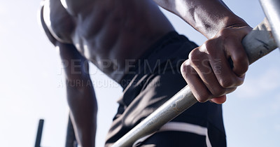 Buy stock photo Closeup shot of an athletic man working out at a calisthenics park