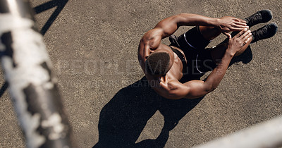 Buy stock photo High angle shot of a muscular young man working out at a calisthenics park