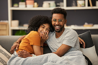 Buy stock photo Cropped shot of a happy young couple sitting on the sofa at home