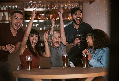 Buy stock photo Shot of a group of young friends cheering while watching a sports game at a bar