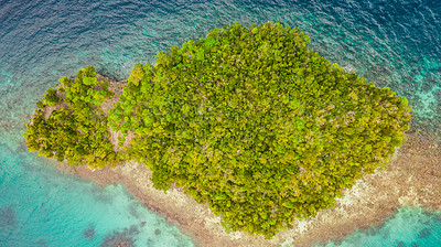Buy stock photo High angle shot of a little islet in the middle of the wonderful Raja Ampat Islands in Indonesia