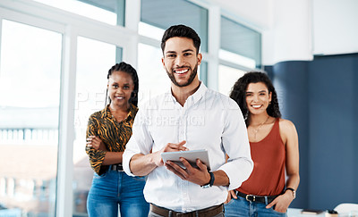 Buy stock photo Cropped portrait of a handsome young businessman standing in front of his colleagues and holding a tablet