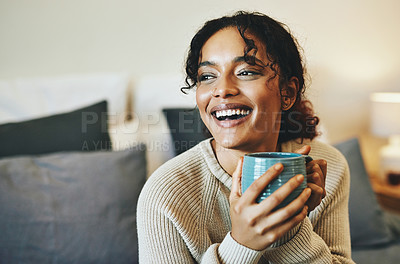 Buy stock photo Cropped shot of an attractive young woman drinking coffee while relaxing at home