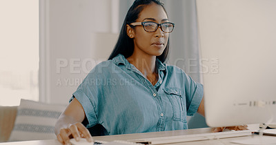 Buy stock photo Shot of an attractive young businesswoman working on a computer inside her office at home