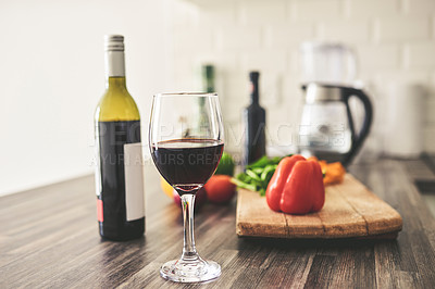 Buy stock photo Closeup shot of red wine and raw ingredient on a kitchen counter