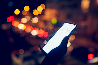 Buy stock photo Cropped shot of an unrecognizable businesswoman using a digital tablet while standing on a balcony at night