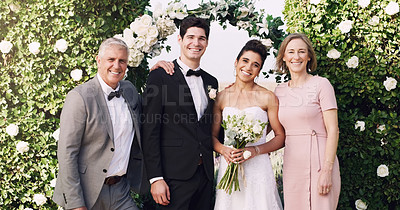 Buy stock photo Cropped portrait of an affectionate young newlywed couple standing with their parents on their wedding day