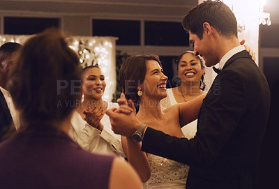 Buy stock photo Cropped shot of an affectionate young newlywed couple dancing in front of their guests at their wedding reception