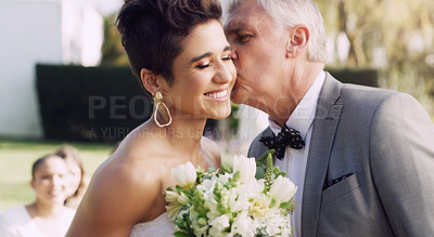 Buy stock photo Cropped shot of an affectionate mature father kissing his daughter on the cheek on her wedding day