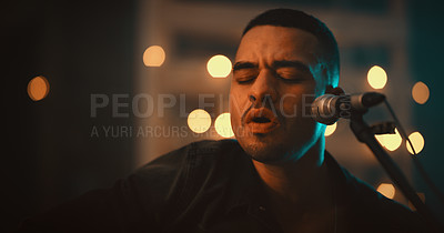 Buy stock photo Shot of a young man singing on stage