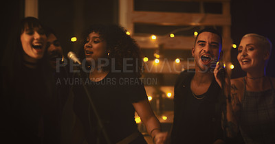 Buy stock photo Shot of a group of people singing on stage in a club