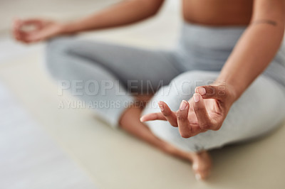 Buy stock photo Cropped shot of a fit woman meditating at home