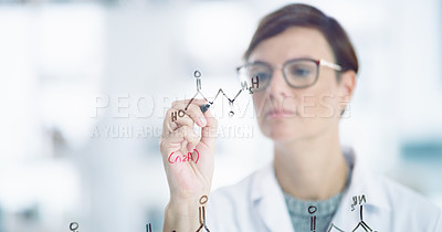 Buy stock photo Closeup shot of a scientist drawing molecular structures on a glass wall in a lab
