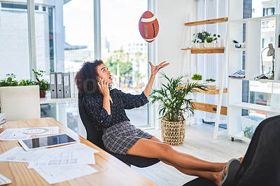 Buy stock photo Full length shot of an attractive young businesswoman playing with a ball while using her cellphone in the office