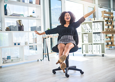Buy stock photo Full length shot of an attractive young businesswoman sitting alone in her office and feeling playful during a break
