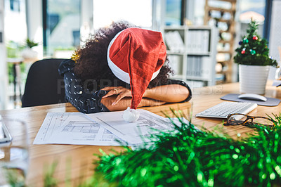 Buy stock photo Cropped shot of an attractive young businesswoman wearing christmas decorations and sleeping on her desk in the office