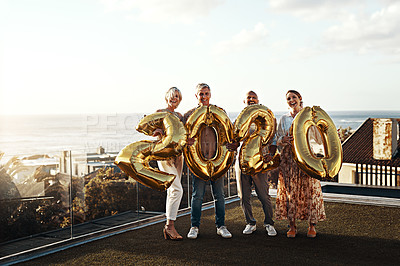 Buy stock photo Full length portrait of an affectionate family holding up balloon numbers reading