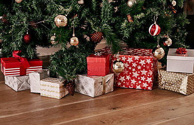 Buy stock photo Cropped shot of a bunch of presents placed under a Christmas tree ready to be opened in the morning