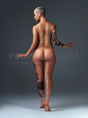 Buy stock photo Rearview shot of a beautiful young woman posing nude in the studio