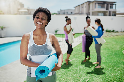 Buy stock photo Portrait of a confident young woman attending a yoga class in a garden