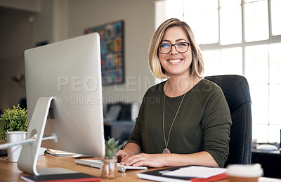 Buy stock photo Portrait of a young businesswoman using a computer in a modern office