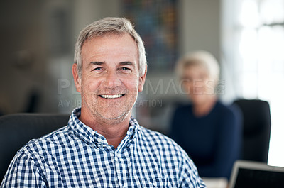 Buy stock photo Portrait of a confident mature businessman sitting in an office