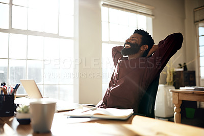 Buy stock photo Shot of a businessman taking a break at his desk in an office