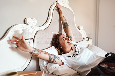 Buy stock photo Cropped shot of a happy young woman waking up from her sleep