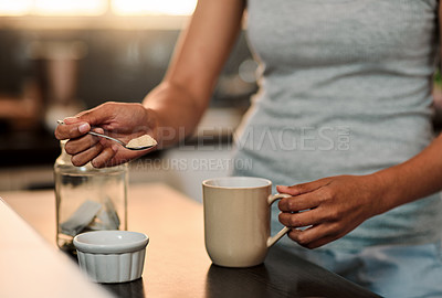 Buy stock photo Cropped shot of a woman making a cup of coffee at home